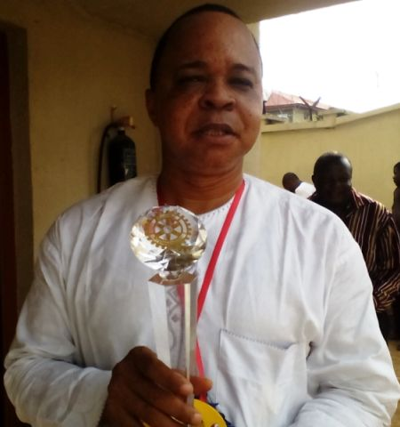 Dr. Nwokolobia displays Award presented to Hon. Tams Brisibe, Delta COS, by Rotary Int'l