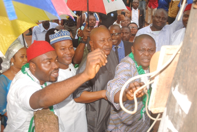 Commissioner for Energy, Hon. Neworld Safugha, flanked by DTHA Speaker, Rt. Hon. Monday Igbuya and Aniocha North Council Chairman, Hon. Osemem switching on the light at Iselle Uku during the occassion