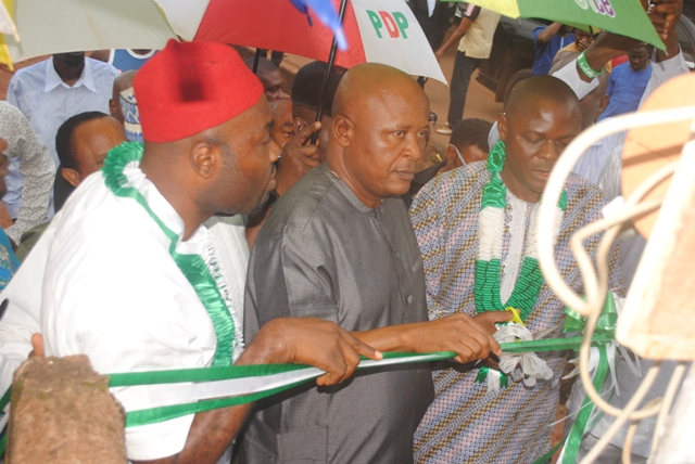 Speaker, DTHA, Rt. Hon. Monday Igbuya (m), Delta State Commissioner for Energy and Aniocha North Council Chairman Ho. Chuks Oseme cutting the tape at the occassion